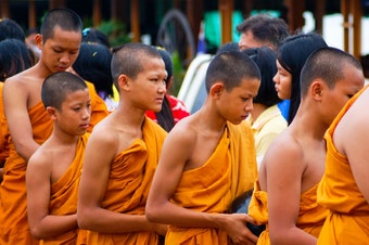 8e45608acc Young monks in Thailand collect offerings of food and other goods in their  bowls. David Ogden